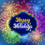 Fireworks. Festive firework bursting in various shapes and colors sparkling on blue night background. Calligraphy inscription Happy Holidays in luminous frame Stock Photo