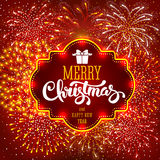 Fireworks. Festive firework bursting in various shapes and red colors sparkling on red background. Calligraphy inscription Merry Christmas in luminous frame Royalty Free Stock Photos