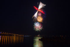 Fireworks finale over water Royalty Free Stock Images