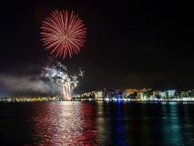 Fireworks, fire castle in the seaside, reflection on the sea at night in Roses , Catalonia, Spain stock photography