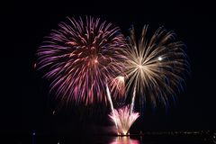 Fireworks. Fire works fire crackers at night over the water Stock Photo