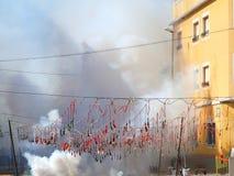 Fireworks firecrackers exploding in smoke street. In Spain fest Stock Images