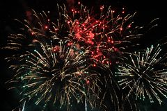 Fireworks. Firework. Heavenly background. Colorful wave of bright red, green and blue sparkling lights in the night sky during the royalty free stock image