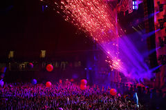 Fireworks firing in the front of crowd at a live concert Royalty Free Stock Image