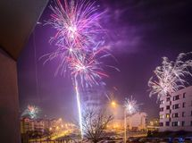 Fireworks firing on New Year`s Eve. City buildings, winter urban landscape Stock Images