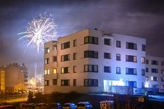 Fireworks firing on New Year`s Eve. City buildings, winter urban landscape Stock Photography