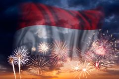 Fireworks and flag of Indonesia. Holiday sky with fireworks and flag of Indonesia, independence day stock photos