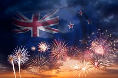 Fireworks and flag of New Zealand. Holiday sky with fireworks and flag of New Zealand, independence day royalty free stock images