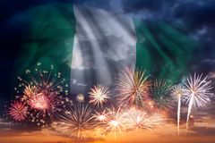 Fireworks and flag of Nigeria. Holiday sky with fireworks and flag of Nigeria, independence day stock image