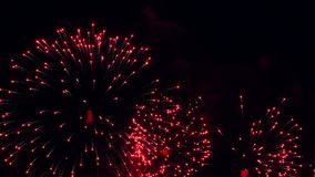 Fireworks flashes in the black sky stock footage