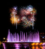 Fireworks by fountain Royalty Free Stock Photo
