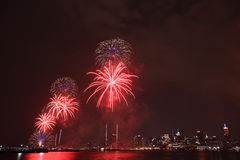 Fireworks on Fourth of July seen from Hoboken riverfront. Royalty Free Stock Images