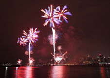 Fireworks on Fourth of July seen from Hoboken riverfront. Royalty Free Stock Photography
