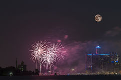 Fireworks with full moon over detroit river. Fireworks along detroit river during canada day celebration Royalty Free Stock Photo