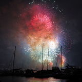Colorful fireworks in harbor over sailing boats Stock Photography