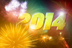 2014 fireworks. Glowing 2014 against colorful fireworks background Royalty Free Stock Photo