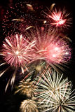 Fireworks Grand Finale. Beautiful fireworks exploding over a dark night sky in a grand finale display Stock Image