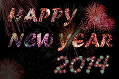 Fireworks. Happy new year 2014 celebration concept with fireworks text and beautiful fireworks in the night Royalty Free Stock Images