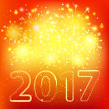 Fireworks for happy new year 2017. On orange background Stock Photos