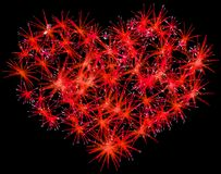 Fireworks heart shape for Valentines Day. Over black Royalty Free Stock Photo