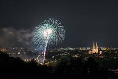 Fireworks of the Herbstdult with Ferris wheel and cathedral in Regensburg, Germany.  stock photo