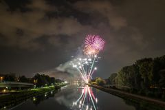 Fireworks of the Herbstdult with Ferris wheel and cathedral in Regensburg, Germany stock photography