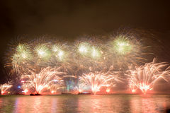 Fireworks in Hong Kong New Year celebration 2017 at Victoria Harbor. View from Tsim Sha Tsui Stock Image