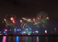 Fireworks in Hong Kong New Year celebration 2017 at Victoria Harbor. View from Tsim Sha Tsui Stock Images