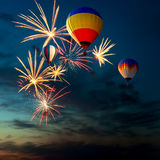 Fireworks and hot air-balloon at sunset Stock Photo