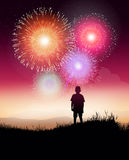 Fireworks with kid. A kid looking a fireworks with hope Stock Photo