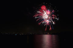 Fireworks on the lake. Bright fireworks light up the sky over a lake Royalty Free Stock Photos