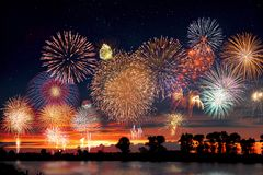 Fireworks at the lake during party event or wedding reception.  stock photo