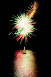 Fireworks on the lake on water Royalty Free Stock Image