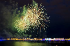 The fireworks and a laser show in the waters of the Neva River i Stock Images