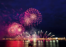 The fireworks and a laser show in the waters of the Neva River i Royalty Free Stock Photo
