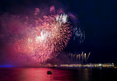 The fireworks and a laser show in the waters of the Neva River i Stock Photos