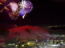 Fireworks launch at Great Bear Ski Hill in Sioux Falls, South Dakota for New Years Eve.  Stock Photography