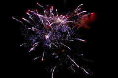 Fireworks light up the sky with dazzling display2. Brightly colorful fireworks and salute of various colors in the night sky Stock Image
