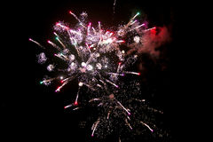 Fireworks light up the sky with dazzling display. Brightly colorful fireworks and salute of various colors in the night sky Stock Image