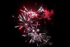 Fireworks light up the sky with dazzling display1. Brightly colorful fireworks and salute of various colors in the night sky Stock Images