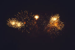 Fireworks light up the sky. New Year celebration Stock Photos