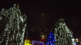 Fireworks light up sky over city. Holidays, celebrating New Year. stock video footage