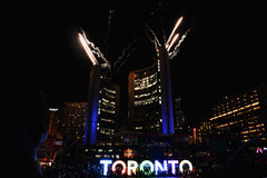 Fireworks light up toronto sky, Pan Am Games closing ceremonies. Dazzling fireworks display at city hall and cn tower in Toronto, on closing ceremonies of Pan Am Royalty Free Stock Image
