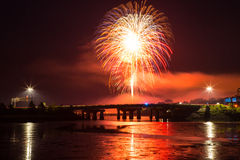 Fireworks and lights over the bridge Stock Images