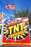 Fireworks. LOS ANGELES, CALIFORNIA - JUNE 29, 2015: TNT Fireworks stand promoting fireworks to celebrate the 4th of July festivities, with the flag of the USA on Royalty Free Stock Photography