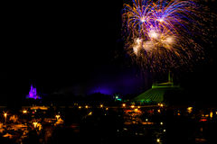 Fireworks at the Magic Kingdom. Fireworks go off behind Cinderella's Castle and Space Mountain in Orlando, Florida Stock Images