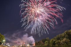 Fireworks of the Maidult with Ferris wheel in Regensburg, Germany.  stock photography