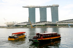 Shuttle boats and Marina bay sand in Singapore Stock Images