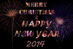 Fireworks. Merry christmas and happy new year 2014 celebration concept with fireworks text and beautiful fireworks in the night Stock Photography