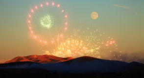 Fireworks and moon Stock Photography